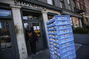 ASSOCIATED PRESS                                 A bread delivery is made to a Shake Shack restaurant in the Brooklyn borough of New York on March 16.