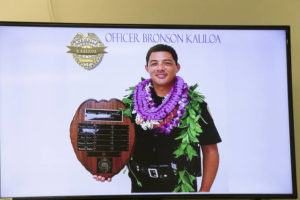 CINDY ELLEN RUSSELL / 2018                                 A photo of Hawaii Police Department officer Bronson Kaliloa is seen on a television screen during a press conference on July 18, 2018, in Hilo.