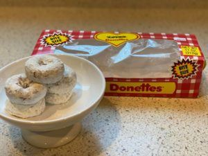 ROSEMARIE BERNARDO / RBERNARDO@STARADVERTISER.COM                                 A coveted box of Love's Bakery's powdered-sugar Donettes is already mostly gone.