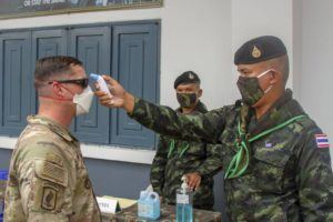 COURTESY U.S. ARMY, SPC. EZRA CAMARENA, 28th PUBLIC AFFAIRS DEPARTMENT                                 1st Sgt. Donald William, 3rd Infantry Brigade Combat Team, 25th Infantry Division, gets his temperature checked as a preventative measure against COVID-19 on March 29 in Krabi, Thailand, by Royal Thai Army medical personnel as part of the Hanuman Guardian exercise.