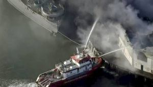 KPIX-TV CBS-VIACOM VIA AP First responders battle a massive fire that erupted at a warehouse early today in San Francisco. Arriving crews were confronted with towering flames engulfing the warehouse.