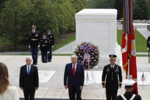 ASSOCIATED PRESS President Donald Trump stands with Vice President Mike Pence and Gen Omar Jones, Commanding General at Joint Force Headquarters, National Capital Region and United States Army Military District of Washington, at the Tomb of the Unknown Soldier in Arlington National Cemetery, in honor of Memorial Day today in Arlington, Va.