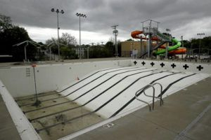 ASSOCIATED PRESS The public pool in Mission, Kan. is lifeless on May 15 as plans remain in place to keep the pool closed for the summer to help prevent the spread of COVID-19. As warm weather approaches and many public pools remain closed there has been a surge of people using backyard pools as well at taking to water activities on lakes and rivers to get out and cool off.