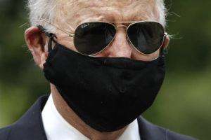 ASSOCIATED PRESS                                 Democratic presidential candidate, former Vice President Joe Biden wears a face mask to protect against the spread of the new coronavirus as he and Jill Biden depart after placing a wreath at the Delaware Memorial Bridge Veterans Memorial Park Monday in New Castle, Del.