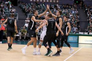 STAR-ADVERTISER / 2019                                 The Hawaii men's volleyball team celebrates after scoring a point in March 2019 at the Stan Sheriff Center. University of Hawaii athletic teams scored a school-record high Academic Performance Rate average of 984 on a scale of 1,000 over a four-year period. The men's volleyball team scored 995 during the same period.