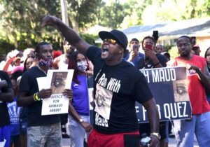 ASSOCIATED PRESS                                 Keith Smith spoke to a crowd as they marched through a neighborhood in Brunswick, Ga., on Tuesday demanding answers regarding the death of Ahmaud Arbery.
