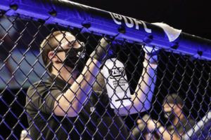 ASSOCIATED PRESS                                 A worker wipes down areas of the octagon between bouts at a UFC 249 mixed martial arts event on May 9 in Jacksonville, Fla.