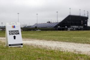ASSOCIATED PRESS                                 A sign directs people to a screening station outside Darlington Raceway today in Darlington, S.C. NASCAR, which has been idle since March 8 because of the coronavirus pandemic, made its return with the Real Heroes 400 Nascar Cup Series auto race today.