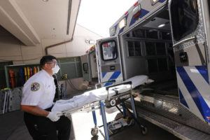 JAMM AQUINO / JAQUINO@STARADVERTISER.COM                                 EMT Ikaika Mollena loads a gurney into his team's ambulance after taking in a patient to the emergency room at Queens Medical Center on May 15. National EMS Week lasts from May 17-23.