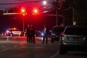NEW YORK TIMES                                 Police officers stood outside the scene of a fatal stabbing in Amityville, N.Y., today.