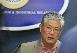 JAMM AQUINO / JAQUINO@STARADVERTISER.COM                                 Scott Murakami, director of the Department of Labor and Industrial Relations, spoke during a March 19 press conference.