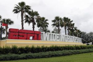 ASSOCIATED PRESS                                 A sign marking the entrance to ESPN's Wide World of Sports at Walt Disney World is seen today in Kissimmee, Fla. The NBA has told the National Basketball Players Association that it will present a 22-team plan for restarting the season at Disney.
