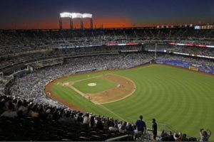 ASSOCIATED PRESS / 2019                                 The sun sets behind Citi Field during a baseball game between the New York Mets and the Chicago Cubs in New York. Major League Baseball players ignored claims by clubs that they need to take additional pay cuts, instead proposing they receive a far higher percentage of salaries and a commit to a longer schedule as part of a counteroffer to start the coronavirus-delayed season.