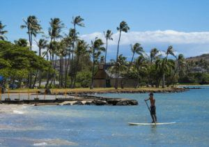 CRAIG T. KOJIMA / CKOJIMA@STARADVERTISER.COM                                 Dakota Tague, paddles at Maunalua Bay Beach after exercising for an hour around the Hawaii Kai area. Oahu's beaches and parks reopened Sept. 10 for solo activities.