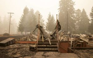 Flames from the Beachie Creek Fire destroyed the Oregon Department of Forestry, North Cascade District Office in Lyons, Ore., Sunday, Sept. 13, 2020. (Rob Schumacher/Statesman-Journal via AP, Pool)
