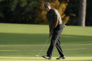 ASSOCIATED PRESS                                 Tiger Woods watches his ball as he misses a birdie putt on the eighth hole during the first round of the Masters golf tournament Thursday in Augusta, Ga.