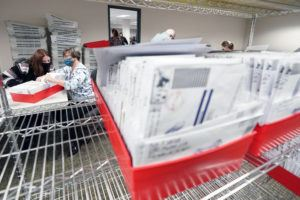 ASSOCIATED PRESS / NOVEMBER 5                                 Lehigh County workers count ballots as vote counting in the general election continued in Allentown, Pa.