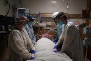 ASSOCIATED PRESS                                 Medical workers prepared to manually prone a COVID-19 patient in an intensive care unit at Providence Holy Cross Medical Center in the Mission Hills section of Los Angeles, Tuesday.