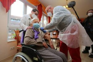 MATTHIAS BEIN/DPA VIA AP                                 Doctor Bernhard Ellendt, right, injects the COVID-19 vaccine to nursing home resident Edith Kwoizalla, 101 years old, in Halberstadt, Germany. The first shipments of coronavirus vaccines have arrived across the European Union as authorities prepared to begin administering the first shots to the most vulnerable people in a coordinated effort on Sunday. The vaccines developed by BioNTech and Pfizer arrived by truck in warehouses across the continent on Friday and early Saturday after being sent from a manufacturing center in Belgium before Christmas.