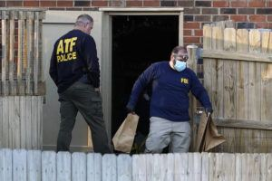 ASSOCIATED PRESS                                 Investigators remove items from the basement of a home Saturday in Nashville, Tenn. An explosion that shook the largely deserted streets of downtown Nashville early Christmas morning shattered windows, damaged buildings, and wounded three people.