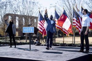ASSOCIATED PRESS                                 Vice President-Elect Kamala Harris, left, campaigns for Democratic U.S. Senate challengers the Rev. Raphael Warnock and Jon Ossoff, right, in Columbus, Ga.