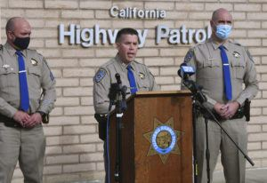 ASSOCIATED PRESS California Highway Patrol Captain Kevin Clays, center, updates the media about Friday's fatal crash on Highway 33 on Saturday in Coalinga, Calif. Investigators are asking for the public's help to determine what led up to a head-on crash that killed seven children and two adults in central California on New Year's Day.