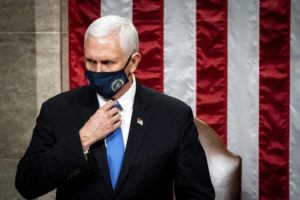 ASSOCIATED PRESS                                 Vice President Mike Pence officiates as a joint session of the House and Senate reconvenes to confirm the Electoral College votes at the Capitol, Wednesday.