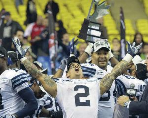 """ASSOCIATED PRESS / 2012                                 Chad Owens hosts the """"The CO2 RUN DWN,"""" the Honolulu Star-Advertiser's new Facebook Live sports talk show. Owens is shown here celebrating a Toronto Argonauts' victory on Nov. 18, 2012, in Montreal."""