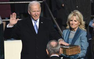 SAUL LOEB/POOL PHOTO VIA ASSOCIATED PRESS                                 Joe Biden was sworn in as the 46th president of the United States by Chief Justice John Roberts as Jill Biden held the Bible during the 59th Presidential Inauguration at the U.S. Capitol in Washington, today.