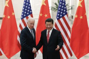 NEW YORK TIMES                                 Chinese President Xi Jinping, right, shakes hands with then U.S. Vice President Joe Biden as they pose for photos at the Great Hall of the People in Beijing in 2013.