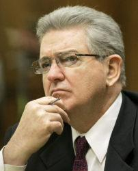 ASSOCIATED PRESS / 2008 Former FBI agent John Connolly listens to the testimony during his trial in Miami. The imprisoned former FBI agent serving a 40-year prison sentence for alerting former Boston mobster Whitey Bulger that he could be implicated in a mob murder wants to be released from prison on medical grounds. Connolly will ask the Florida Commission on Offender Review Wednesday, Feb. 17, to release him.