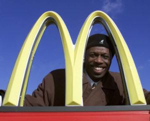 ASSOCIATED PRESS                                 Herb Washington poses for a portrait outside his McDonalds restaraunt in Niles, Ohio, in 2002. Washington, the Black owner of 14 McDonald's franchises in Ohio has sued the corporation in federal court asserting numerous instances of unfair treatment compared with white owners.