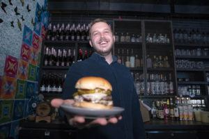 ASSOCIATED PRESS                                 Josh Phillips, the co-owner of Espita, a stylish Mexican restaurant, held a Ghostburger at his restaurant in downtown Washington, Feb. 15. Phillips opened a delivery-only brand called Ghostburger in August to keep Espita's kitchen running through the winter.