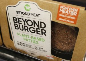 ASSOCIATED PRESS                                 A meatless burger patty called Beyond Burger by Beyond Meat is displayed at a grocery store in Richmond, Va., in 2019. Plant-based food company Beyond Meat will be partnering with several major fast food chains in the coming years to expand offerings that could eventually include plant-based burgers, chalupas or toppings on a stuffed-crust pizza.