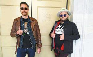 """COURTESY U.S. DEPARTMENT OF JUSTICE                                 Proud Boys Hawaii founder Nick Ochs, left, and his alleged accomplice Nicholas DeCarlo posed next to the words """"Murder the media"""" scrawled in a door of the U.S. Capitol on Jan. 6."""