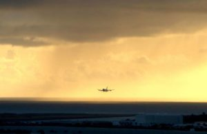 ASSOCIATED PRESS / APRIL 2020                                 A plane landed as the sun set over the Pacific Ocean in Honolulu. More than 200 people gathered on Kauai to show support for reopening tourism on the island amid the coronavirus pandemic.