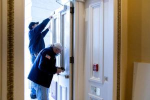 NEW YORK TIMES                                 Workers repair an entrance of the Capitol building in Washington on Wednesday.
