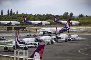 CINDY ELLEN RUSSELL / 2020                                 A fleet of Hawaiian Airlines airplanes were parked on the tarmac of Daniel K. Inouye International Airport.