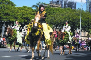 KAT WADE / 2016                                 The 100th annual King Kamehameha Day Floral Parade beginning at the historic ʻIolani Palace in downtown Honolulu.