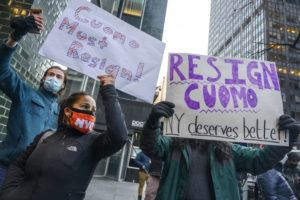 ASSOCIATED PRESS                                 People rally for New York Gov. Andrew Cuomo's resignation in front of his Manhattan office in New York.