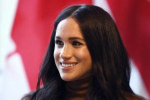 ASSOCIATED PRESS / JAN. 7 Meghan, Duchess of Sussex smiles during her visit with Prince Harry to Canada House, in London.