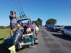 ASSOCIATED PRESS                                 John Fitzgerald, left, on holidays with his wife Rita and friends, scans the horizon from high ground for any sign of a tsunami near Waitangi, New Zealand, Friday.