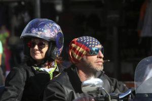 SAM THOMAS /ORLANDO SENTINEL VIA AP                                 Two people ride down Main Street in Daytona, Fla., during the start of Bike Week.