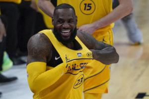 ASSOCIATED PRESS                                 Los Angeles Lakers forward LeBron James walks onto the court for the first half of basketball's NBA All-Star Game in Atlanta, Sunday.