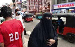 ASSOCIATED PRESS                                 A burqa clad Sri Lankan Muslim woman walks in a street of Colombo, Sri Lanka. Sri Lanka on Saturday announced plans to ban the wearing of burqas and said it would close more than 1,000 Islamic schools known as madrassas, citing national security.