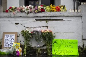 ATLANTA JOURNAL-CONSTITUTION VIA AP                                 Flowers and signs are displayed at a makeshift memorial outside of the Gold Spa in Atlanta on Wednesday.