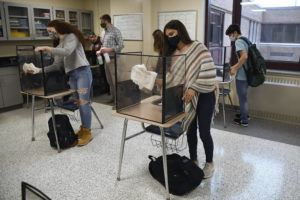 ASSOCIATED PRESS                                 Students in teacher Christopher Duggan's science class cleaned their work areas, Thursday, at the end of class at Windsor Locks High School in Windsor Locks, Conn. The Centers for Disease Control and Prevention relaxed its social distancing guidelines for schools, today, saying students can now sit 3 feet apart in classrooms.