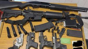 This photo provided by the Atlanta Police Department shows weapons Rico Marley was armed with at the time of his arrest on Wednesday, March 24, 2021. Authorities say Marley, who walked into an Atlanta grocery store with multiple guns and body armor, was spotted by a witness who immediately became suspicious and alerted management. (Atlanta Police Department via AP)