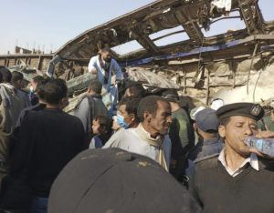 ASSOCIATED PRESS / MARCH 26                                 An Egyptian policeman drinks water as villagers look for remains of victims around mangled train carriages at the scene of a train accident in Sohag, Egypt. Egyptian officials say two trains collided in southern Egypt in the latest in a series of deadly accidents along Egypt's troubled rail system, which has been plagued by poor maintenance and management.