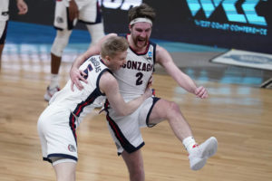 ASSOCIATED PRESS                                 Gonzaga forward Drew Timme (2) celebrates with Gonzaga guard Martynas Arlauskas (5) after an Elite 8 game against Southern California.